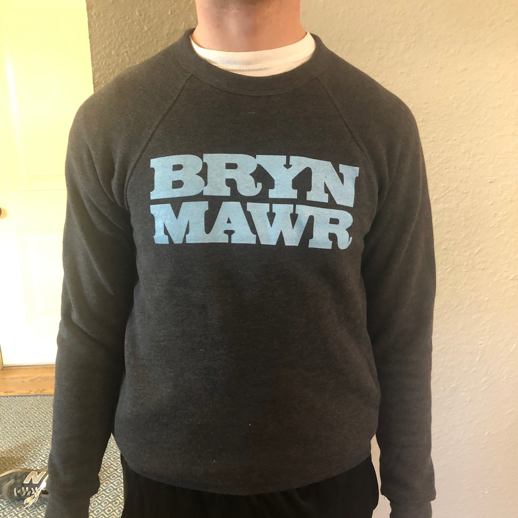 dark heather gray crew neck with light blue lettering